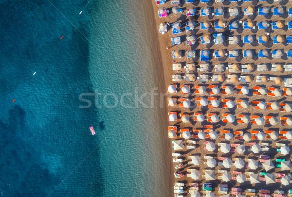 Natation femme gonflable matelas mer Photo stock © denbelitsky