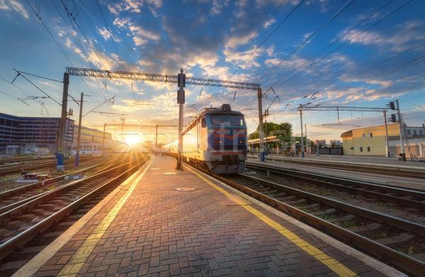 Tren movimiento ferrocarril tema puesta de sol Foto stock © denbelitsky