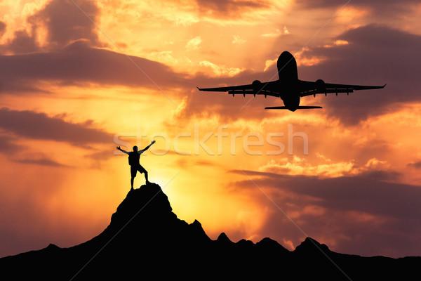 Sagome aeromobili piedi felice uomo braccia Foto d'archivio © denbelitsky