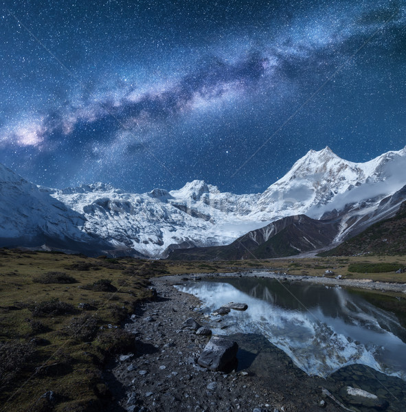Milky Way and high mountains. Night landscape Stock photo © denbelitsky