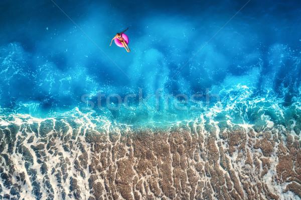 Donna nuoto mare rosa Foto d'archivio © denbelitsky