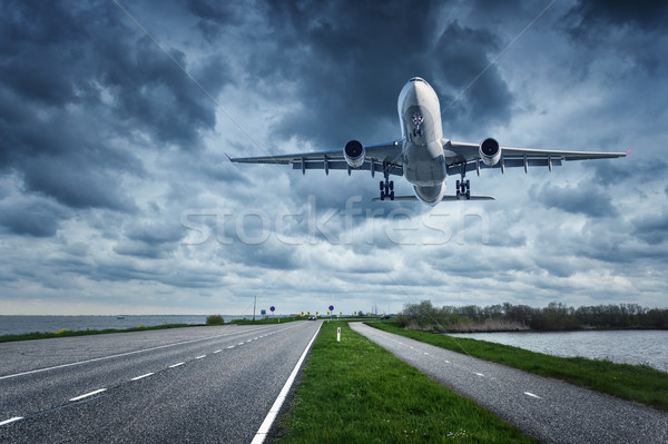 Airplane and road in overcast day Stock photo © denbelitsky
