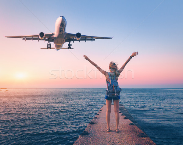 Airplane and happy woman at sunset. Summer landscape Stock photo © denbelitsky