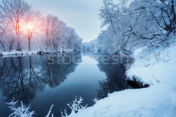 Winter bos rivier zonsondergang kleurrijk landschap Stockfoto © denbelitsky