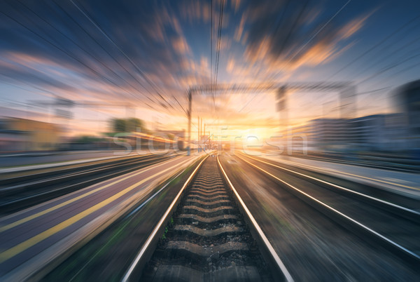 Railway station with motion blur effect. Blurred railroad Stock photo © denbelitsky