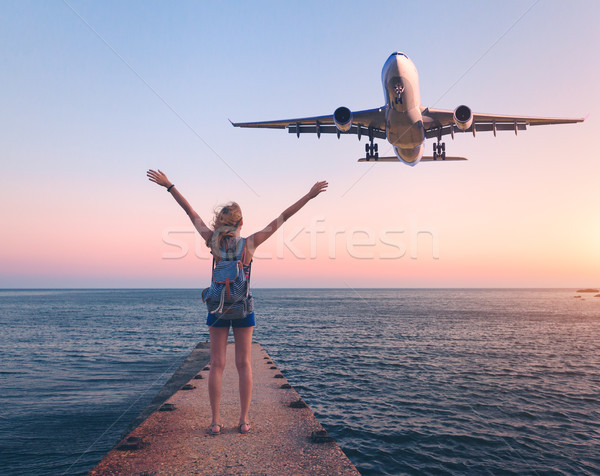 Airplane and woman at sunset Stock photo © denbelitsky