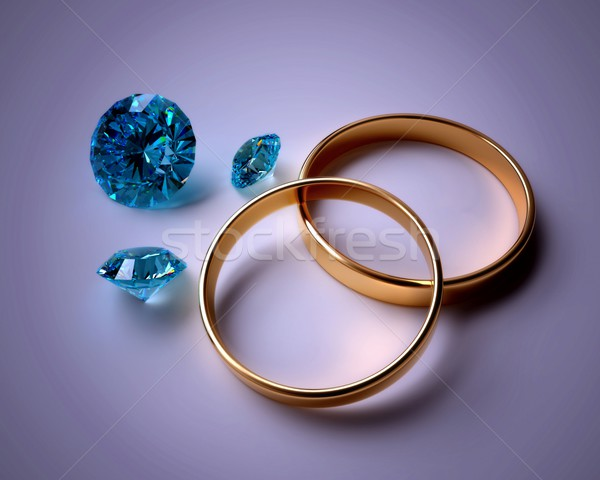 wedding rings and blue gems Stock photo © dengess
