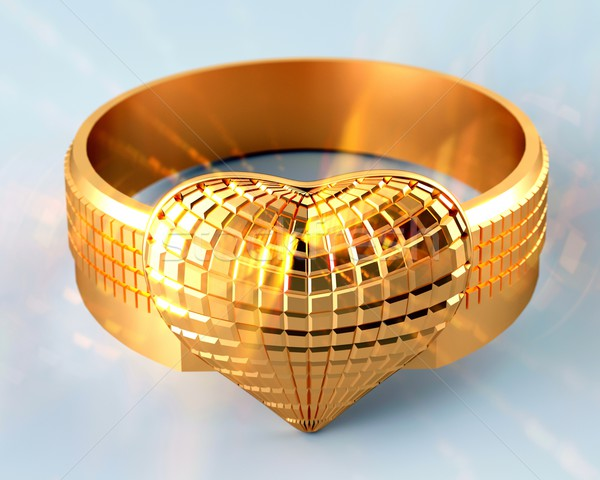Golden ring in the shape of a heart Stock photo © dengess