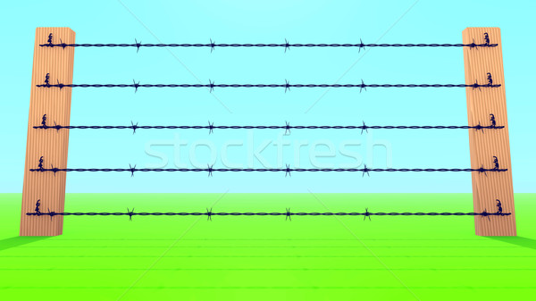 Barb Wire Fence against blue sky. Stock photo © dengess