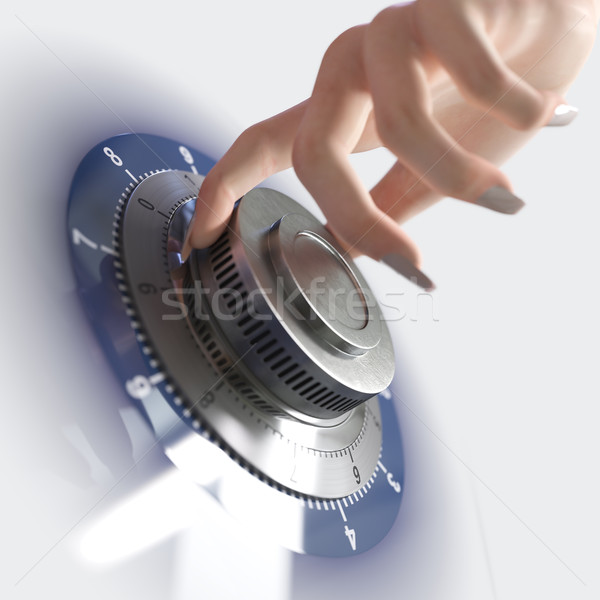 Close up of a safe lock and woman hand conceptual image for security and business Stock photo © denisgo