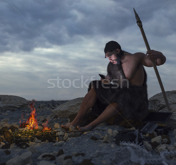 primitive man siting on the stone with smartphone concept illustration Stock photo © denisgo