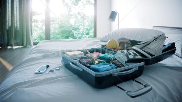 open travel case in hotel bedroom travel vacation concept background Stock photo © denisgo