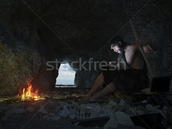 primitive man siting in the cave with smartphone concept illustration Stock photo © denisgo