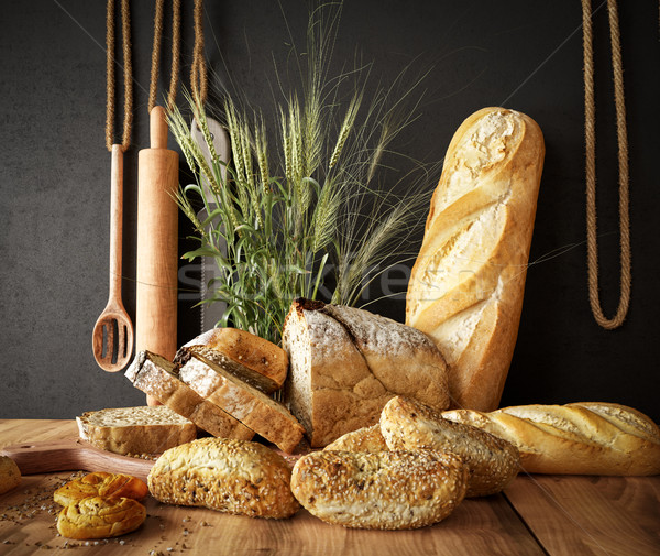 Fresh bread with wheat on a slate cutting board and photo background copy space Stock photo © denisgo