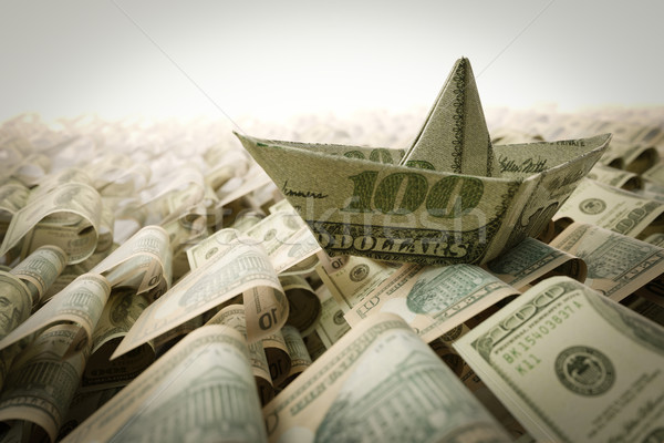 Stock photo: Ship from dollar paper in the money sea concept composition photo