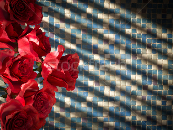 red rose on tiled wall decorative concept background Stock photo © denisgo