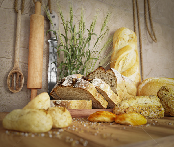 Fresh bread with oat sliced on a slate cutting board photo background copy space Stock photo © denisgo
