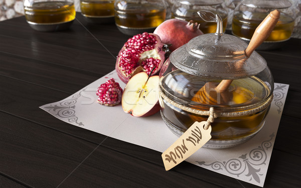 Honey jar with apples and pomegranate for Jewish New Year Holiday Stock photo © denisgo
