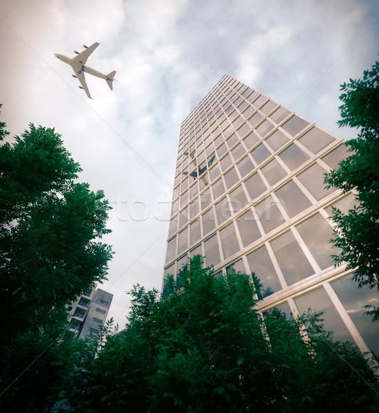 Gebouwen vliegen vliegtuig bomen business toerisme Stockfoto © denisgo