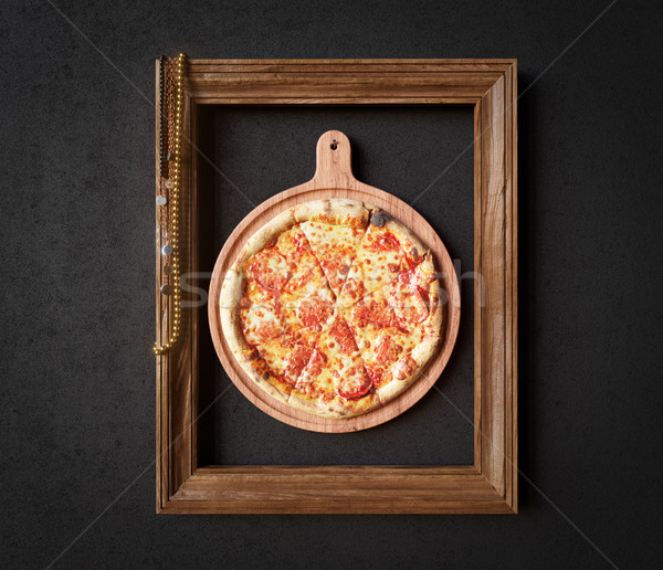 Hot pizza slice with melting cheese with frame concept close up photo Stock photo © denisgo