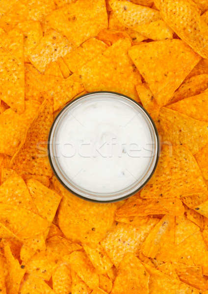 Glass container with sour cream dip and nachos  Stock photo © DenisMArt