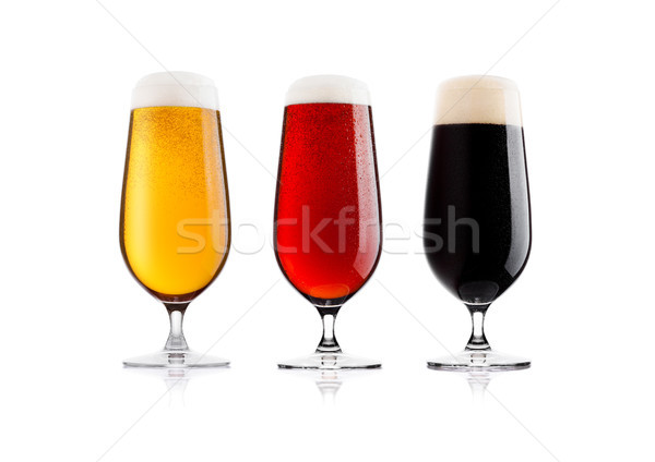Cold glasses of lager stout and red beer with dew Stock photo © DenisMArt