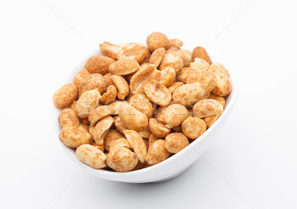 Stock photo: Salty peanuts snack in white bowl