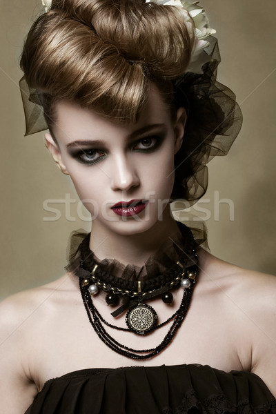 Fashion model with gothic makeup and black jewelry Stock photo © DenisMArt