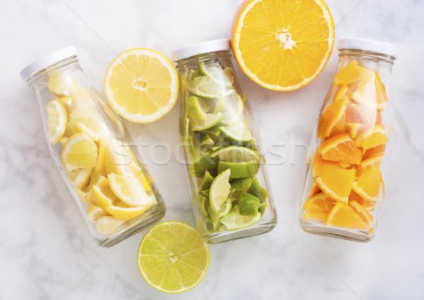Stock fotó: üvegek · narancsok · citromok · szeletek · friss · nyár