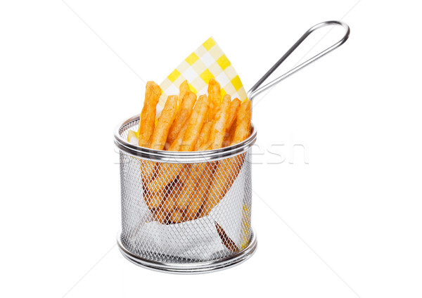 Basket of freshly made southern fries with paper Stock photo © DenisMArt
