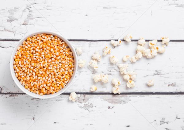White bowl with raw sweet corn and popcorn on wood Stock photo © DenisMArt
