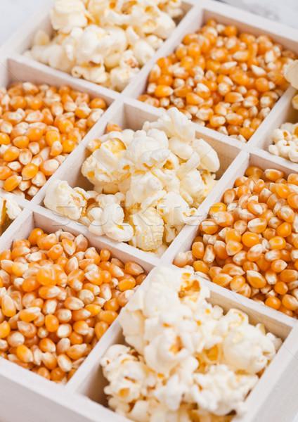 Raw golden sweet corn seeds and popcorn in box Stock photo © DenisMArt