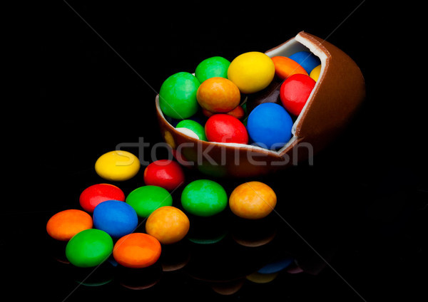 Chocolate egg with colorful small round candies Stock photo © DenisMArt