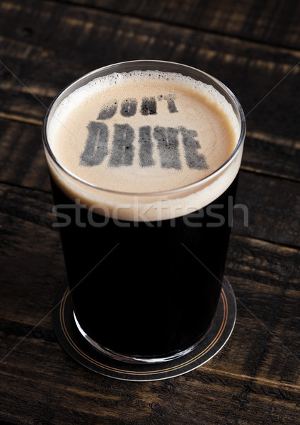 Glass of stout beer top with don't drive shape Stock photo © DenisMArt