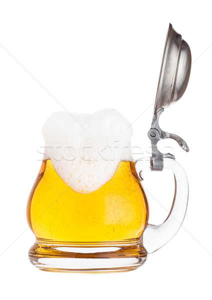 Vintage retro glass of lager ale beer with foam. Glass handle with silver steel top. Stock photo © DenisMArt