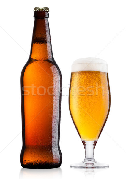 Cold bottle and glass of lager beer with foam  Stock photo © DenisMArt