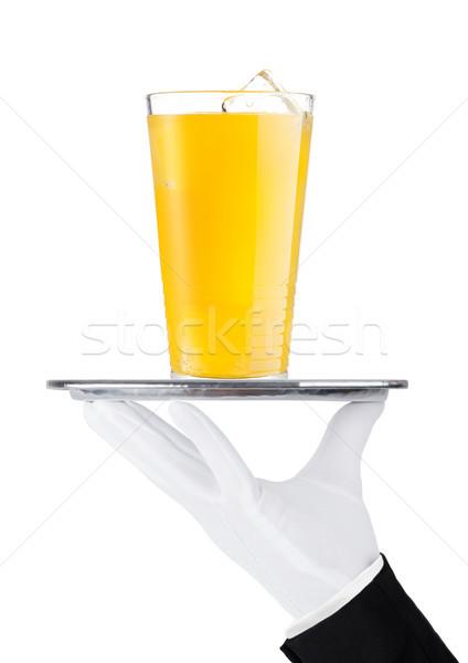 Mão luva bandeja vidro laranja soda Foto stock © DenisMArt