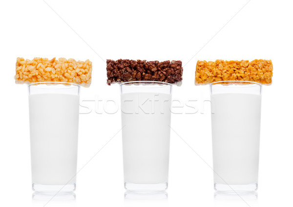 Glasses of fresh breakfast milk with cereal bar Stock photo © DenisMArt