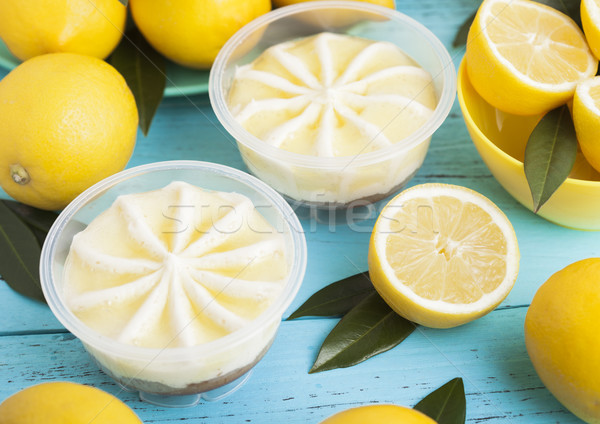 Plastic jar with lemon cheesecake mousse dessert Stock photo © DenisMArt