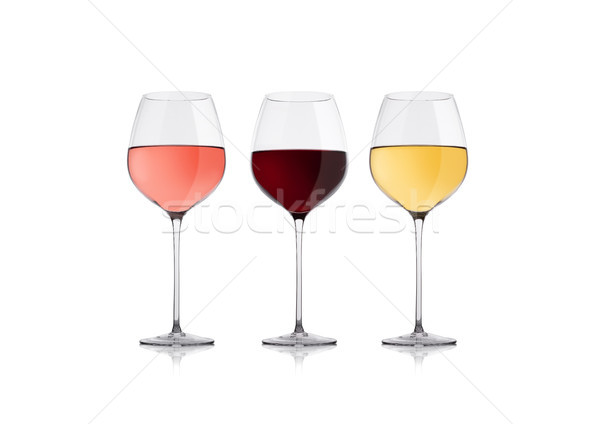 Glasses of white red and pink rose wine on white Stock photo © DenisMArt