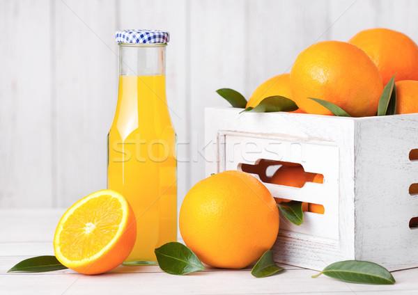 Vidrio botella crudo orgánico frescos jugo de naranja Foto stock © DenisMArt
