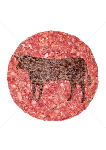 Raw fresh large beef burger with cow shape  Stock photo © DenisMArt