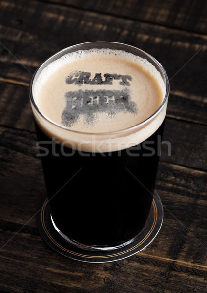 Glass of stout beer top with craft beer shape Stock photo © DenisMArt