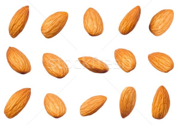 сырой орехи различный форма изолированный Сток-фото © DenisMArt