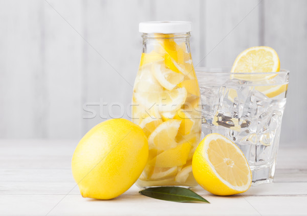 Verre bouteille citron fruits eau limonade Photo stock © DenisMArt