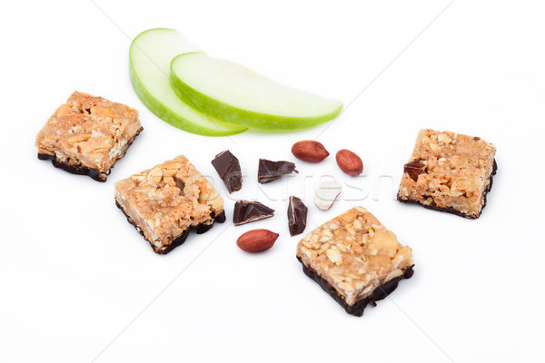 Cereal bar bits apple chocolate and peanuts Stock photo © DenisMArt