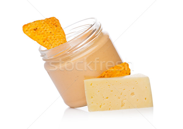 Verre contenant fromages nachos puces Photo stock © DenisMArt