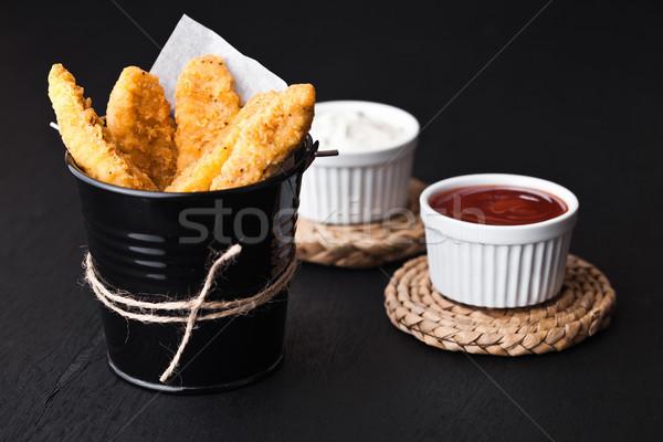 Frango assado preto balde molho crianças restaurante Foto stock © DenisMArt