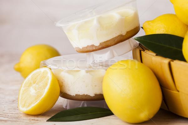 Plastica jar limone cheesecake dessert greggio Foto d'archivio © DenisMArt