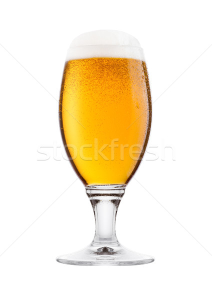 Cold glass of lager beer with foam and dew Stock photo © DenisMArt